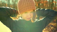 Video portrait of 16-years-old pretty girl walking outdoor at fall
