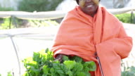 Video portrait of Traditional African Woman Organic Farmer