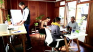 Video portrait young African businessman is shared creative work space