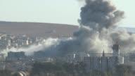 A video shot from Suruc district of Sanliurfa Turkey near TurkishSyrian border crossing shows smoke rising from the Syrian border town of Kobani...