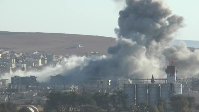A video shot from Suruc district of Sanliurfa Turkey near TurkishSyrian border crossing shows smoke rising from the Syrian border town of Kobani...