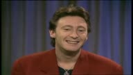 Video Smash Hits interview with Kym Wilson Michael Horrock JULIAN LENNON Talks about traveling for the last 7 months through Europe and now his...