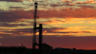 HD video Sunrise oil drill rig flare Weld County Colorado