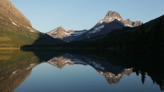 HD video Swiftcurrent Lake and mountain reflections Glacier National Park