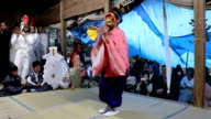 "A video taken on April 8 Japan shows a rare ""sarumai"" monkey dance being performed by two young girls at Hiyoshijinja shrine in the Tokoji district..."