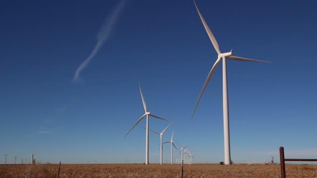 HD video Vega wind turbine farm with crops Texas
