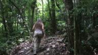 HD video woman hikes Nosy Mangabe Island Reserve rainforest Madagascar