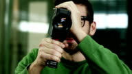 Videographer filming with super 8 video camera