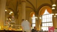 Vienna cafe with waiter.looking at cakes.Medium shot
