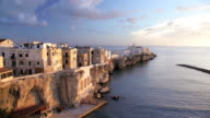 Vieste town built on famous point called Pizzomunno a vertical rocky monolith, Promontorio Del Gargano, Puglia, Italy, Europe