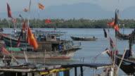 WS LD Vietnamese Flags on Wooden Boats Waving in Breeze / Vietnam