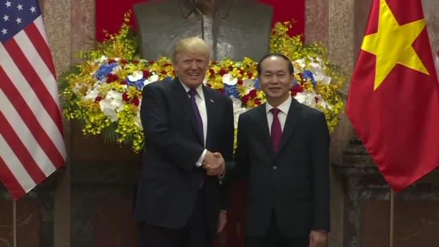 Vietnamese President Tran Dai Quang welcomes his US counterpart Donald Trump at Hanoi's Presidential Palace