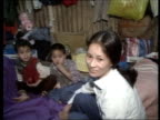 Vietnamese refugees HONG KONG Sham Shui Po refugee camp MS Vietnamese children to fro in dormitory block EXT TMS Refugees in barbedwire surrounded...
