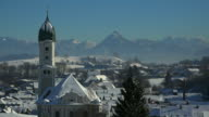 View across the snow covered Town of Nesselwang in the Allgaeu, Swabia, Bavaria, Germany