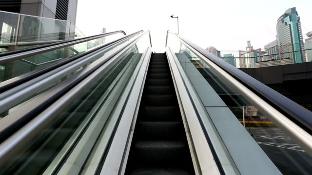 view at moving escalator and cityscape come out at last