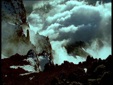 View down from summit of Mount Kibo, snow and cloud