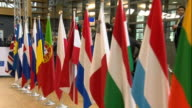 View from a camera walking past European flags in the European parliament building in Brussels