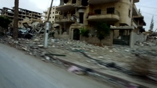 View from a car driving through the streets of Raqqa Syria