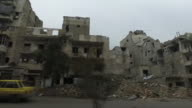 View from a car of destroyed buildings in Aleppo