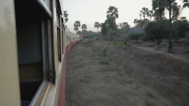 MS, POV View from a train travelling through Myanmar countryside / Bagan, Myanmar