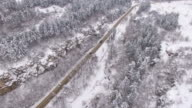 4K View from above of snow forest and road