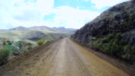 WS T/L POV View from car moving along dirt road / South Africa