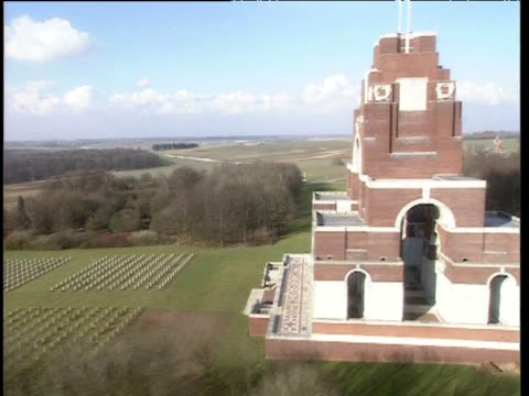 View from helicopter alongside Thiepval memorial track left past rows of gravestones Somme