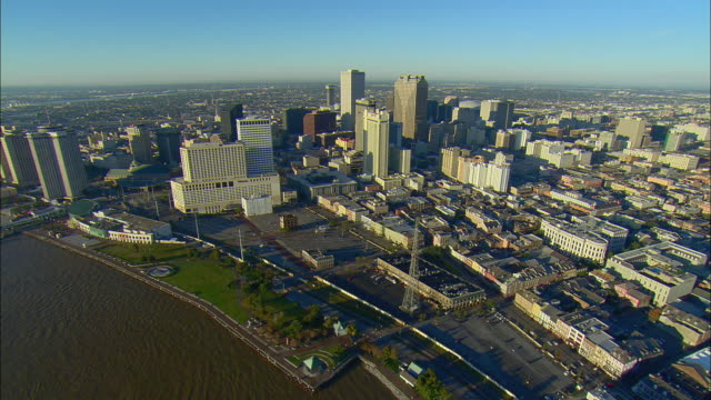 WS POV AERIAL View from over Mississippi River up and over downtown buildings / New Orleans, Louisiana, USA