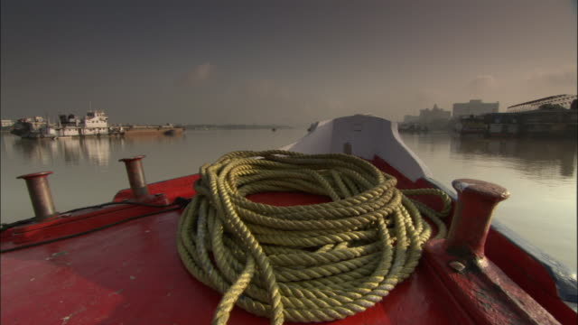 View from prow of boat travelling along Hooghly River, Kolkata Available in HD.