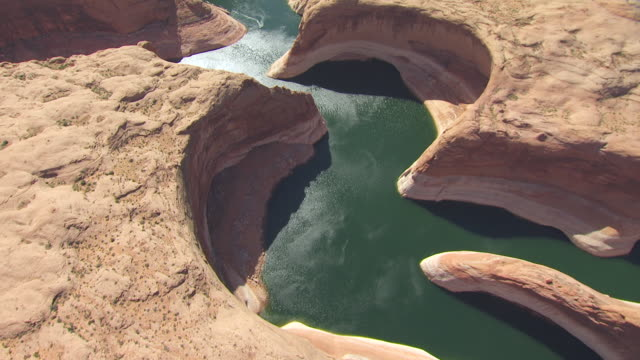 MS AERIAL View high angle flying over Moqui Canyon in Glen canyon national recreation area / Utah, United States