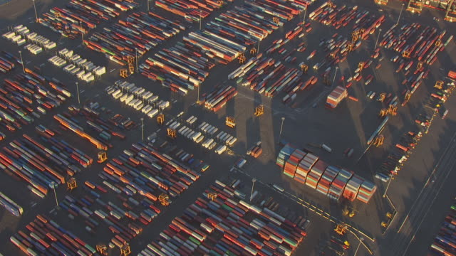 WS AERIAL View high flying over container transporters at Elizabeth Marine Terminal at port / Newark, New Jersey, United States