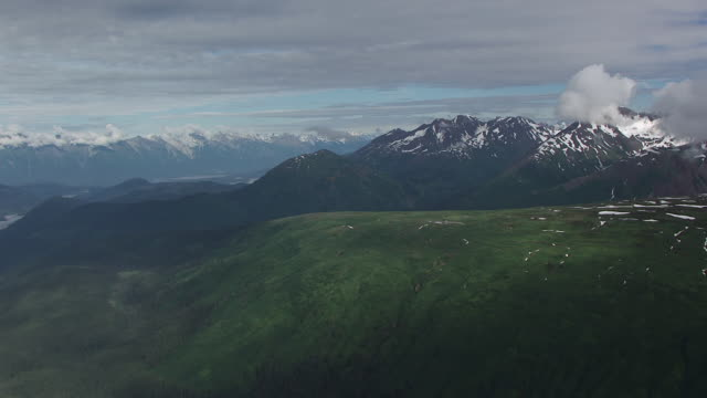 WS AERIAL TS View high over summits and helicopter / Alaska, United States