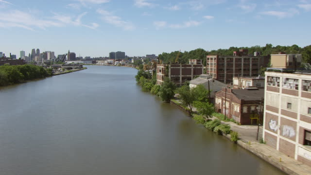 WS AERIAL View low flying over Passaic river / Newark, New Jersey, United States