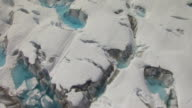 MS AERIAL View low over crevasses with ponds at Bering Glacier / Alaska, United States