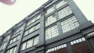 CU TD View of 1900's warehouse style building and colorful iconic street level graffiti art / London, Greater London, UK