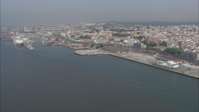 WS POV View of 25 de Abril bridge at Tejo river near Alcantara / Lisbon, Portugal