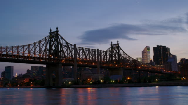 WS TL view of 59th Street Bridge and Midtown Manhattan from Long Island City from dusk to night/ New York City