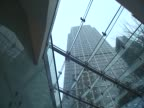 View of a building in Canary Wharf from an escalator going up London