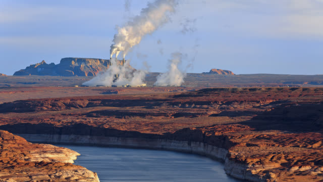 T/L View of a distant powerplant beyond Lake Powell / Page, Arizona, USA