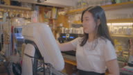 View of a female barista at counter in coffee shop