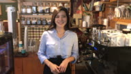 View of a female barista in coffee shop