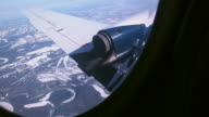 View of a plane wing from the inside while flying