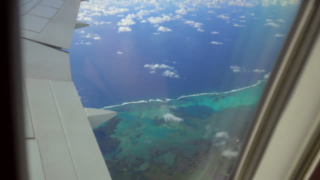 View of a tropical island from airplanes window