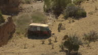 WS AERIAL DS View of abandoned bus in southeast New Mexico desert / New Mexico, United States