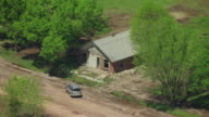 WS AERIAL ZO View of Abandoned house with truck in front of abandoned town at Tar Creek Superfund Site / Treece, Oklahoma, United States