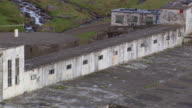 WS AERIAL View of Abandoned Ship and old Factory / Iceland