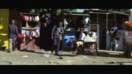 WS POV View of African street stalls