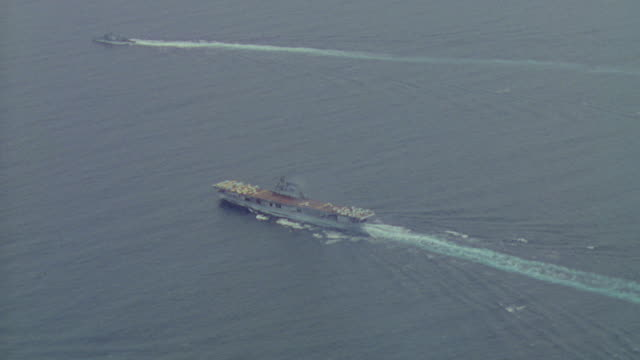 WS AERIAL TS View of aircraft carrier along with another large ship in ocean