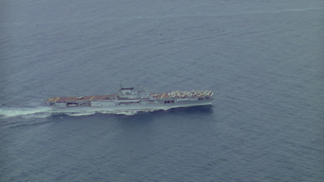 WS AERIAL TS View of aircraft carrier in ocean