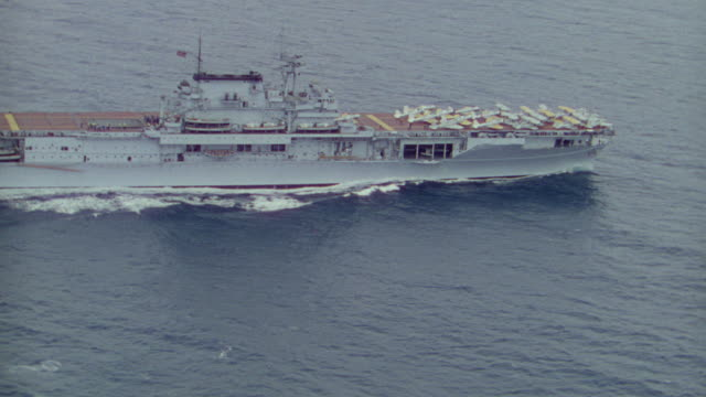 WS AERIAL TS View of aircraft carrier loading with planes